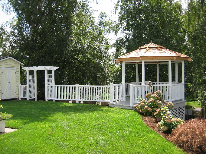 A vinyl gazebo and arbor border this yard in Vancouver, WA