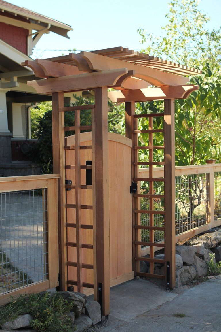 The Hoodoo Arbor creates a formal entryway for this Portland front yard gate