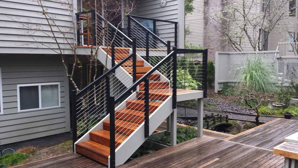 Black aluminum cable railing on wood stairs